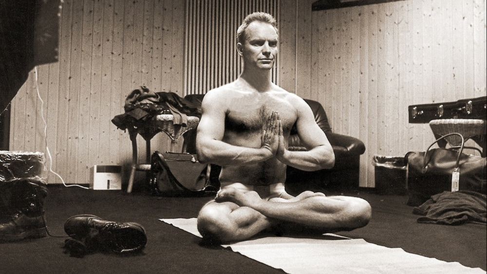 Sting practicing yoga sat in meditation posture